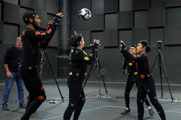 Three girls and Joe Gomez wearing motion capture technology suits