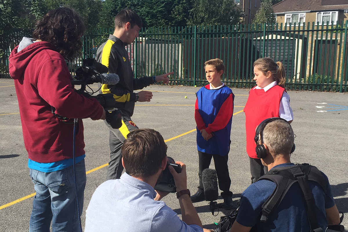Pupils being filmed at Kingsway Junior School in Watford.