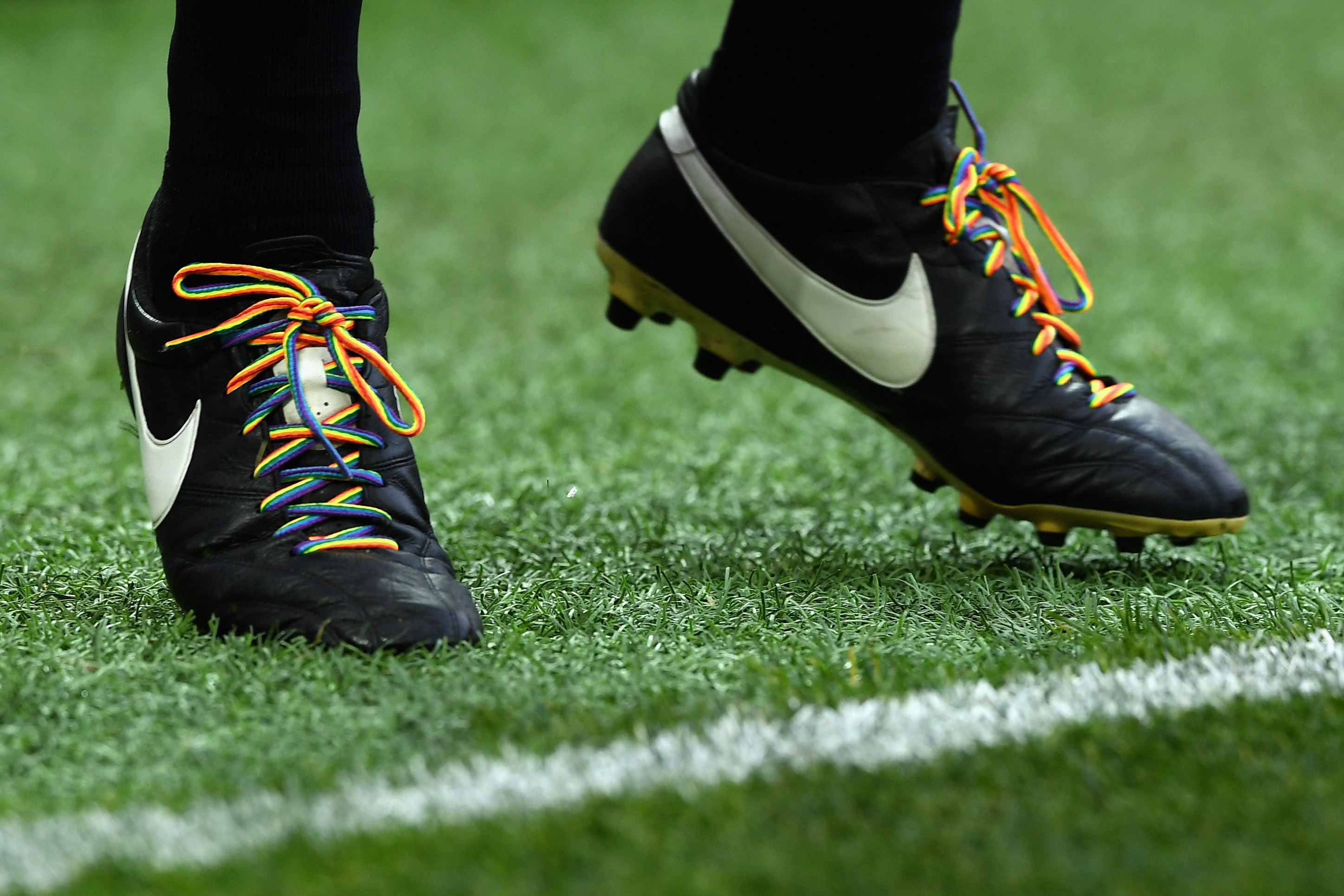 Image of football boots with rainbow laces.