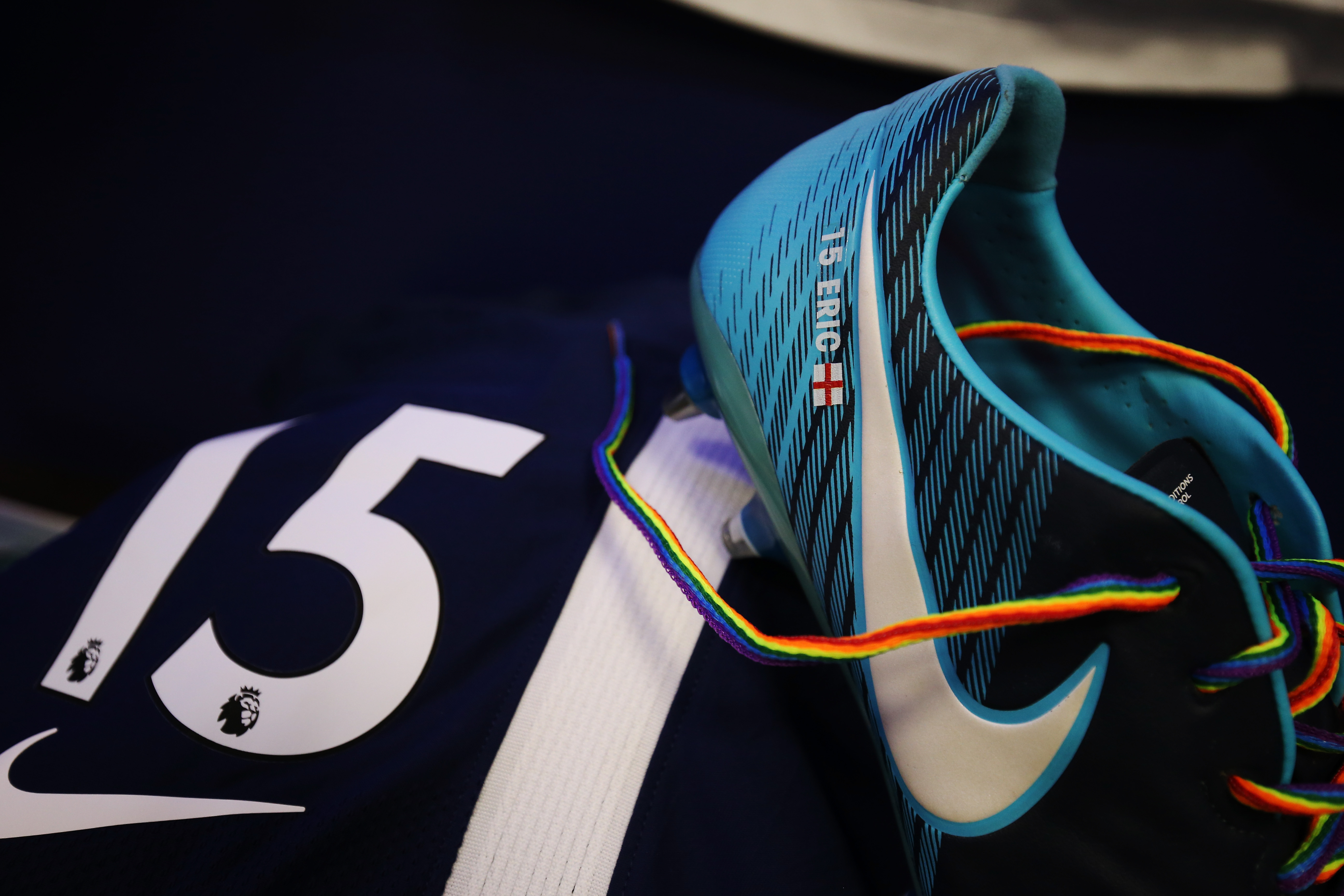 Photo displays a football boot with rainbow laces.
