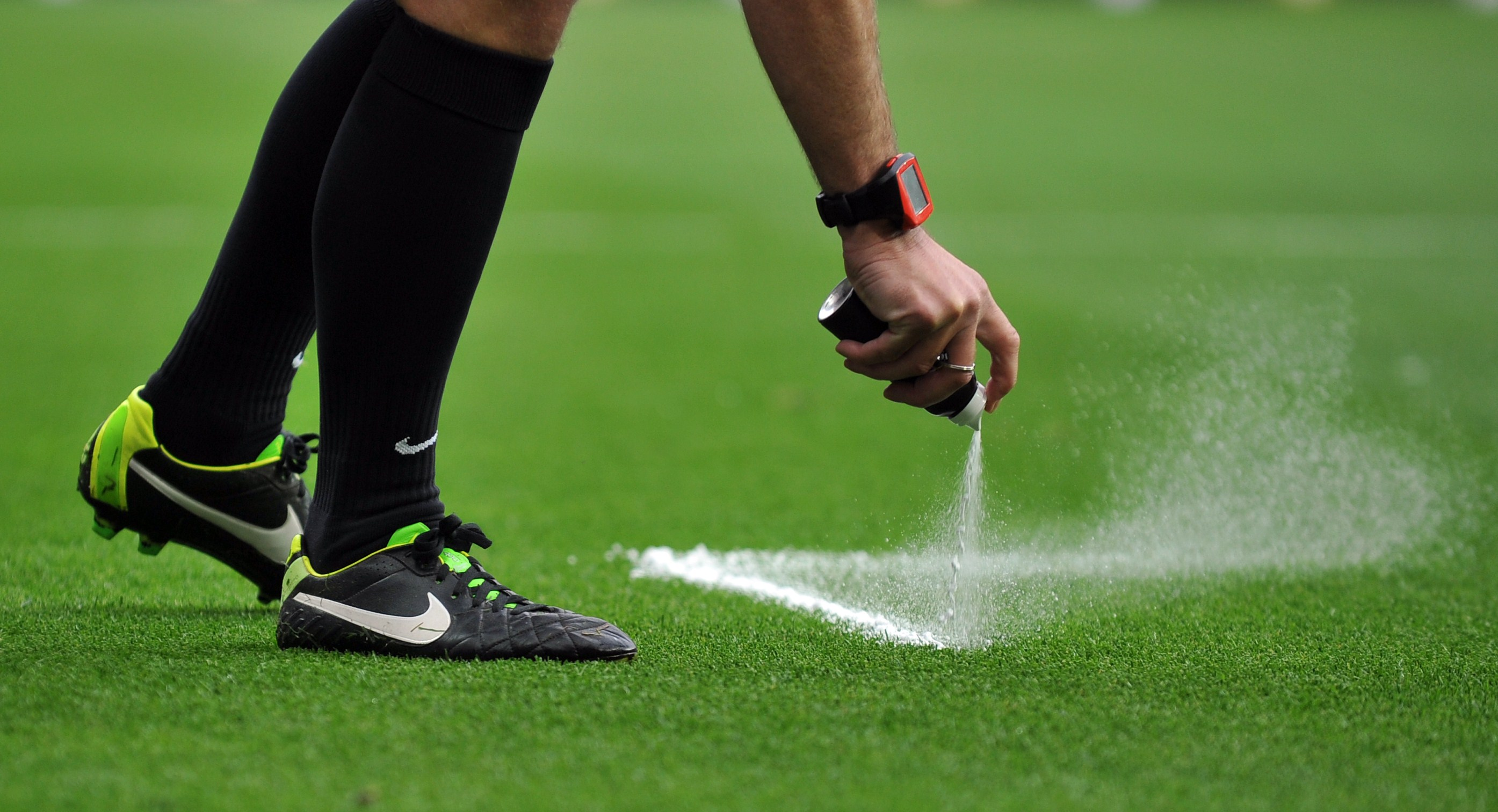 Referee sprays a line