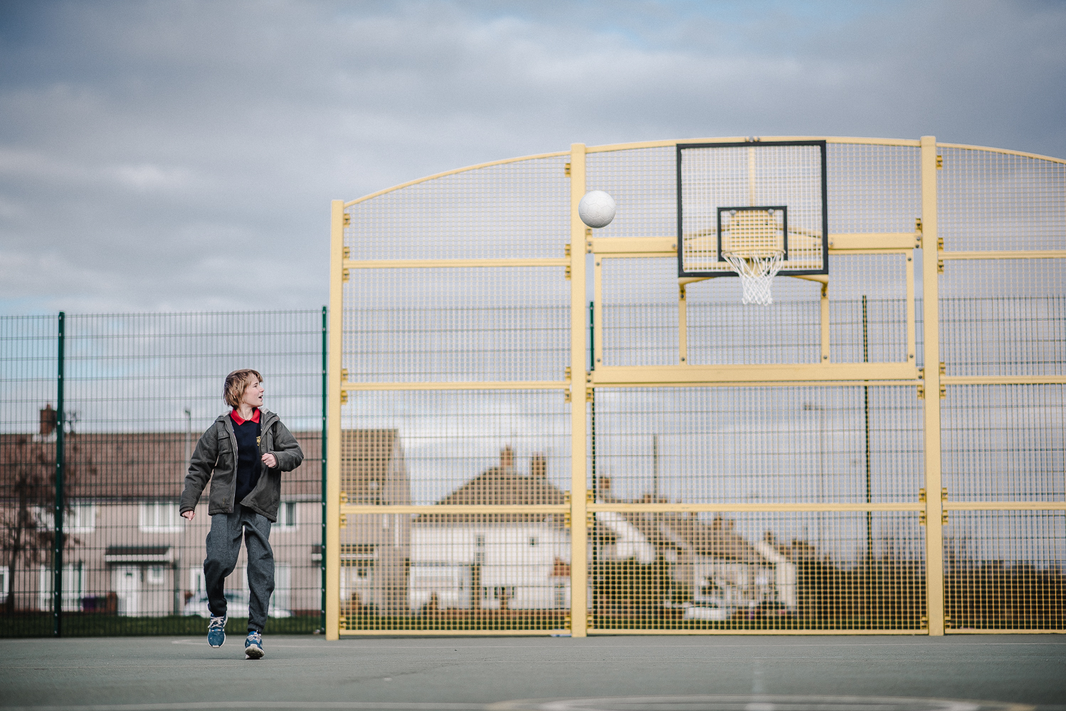 Young person on a basketball court